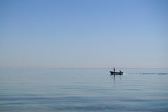 Two men on a motor boat in the sea royalty free stock images