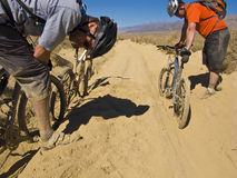 Two men mountain biking. Royalty Free Stock Photos