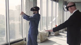 Two men in oculus rift discussing window design stock footage