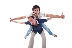 Two men, one carrying on his back the other Stock Images