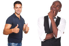 Two men, one thinking and other with thumbs up Royalty Free Stock Image