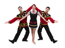 Two men and one woman wearing a folk russian costume posing. Two men and one women wearing a folk russian costume posing against isolated white background Royalty Free Stock Image