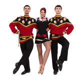 Two men and one woman wearing a folk russian costume posing Stock Images