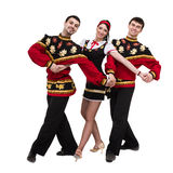 Two men and one woman wearing a folk russian costume posing. Two men and one women wearing a folk russian costume posing against isolated white background Stock Photos