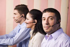 Two men and one women working in office royalty free stock images
