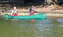 Two men paddling a canoe Royalty Free Stock Photo