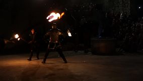 Two men perform visually stunning fight with torches stock video footage