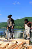 Two men in period dress,cutting wood,Fort Ticonderoga,New York,2014 Royalty Free Stock Photography