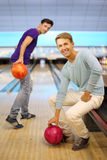 Two men play in bowling club; Royalty Free Stock Image