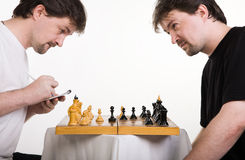 Two men play a chess Royalty Free Stock Photos