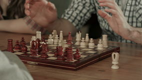 Two men play chess stock video