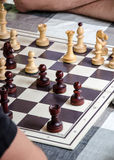 mind game - two men playing chess, chess board and wooden chess pieces Stock Photography