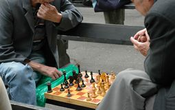 Two men play chess royalty free stock photos