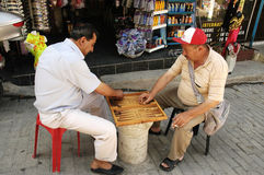 Two men play their favorite game on the street Stock Images