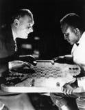 Two men playing backgammon Royalty Free Stock Photo