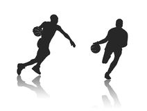 Two men playing basketball. Two men silhouettes playing basketball Royalty Free Stock Photo