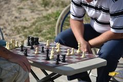 Two men playing chess at the beach in Venice Beach, CA Stock Photos