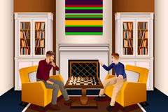 Two Men Playing Chess in the Living Room Stock Photo