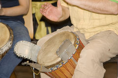 Two men playing djembe Royalty Free Stock Photo