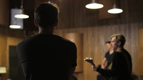 Two Men Playing Electric Guitars Seen From the Side. Music band rehearsal. Medium shot. Shot on RED Epic stock footage