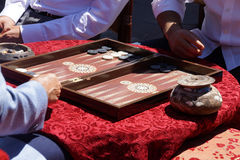 Two men playing a game of backgammon Royalty Free Stock Photo