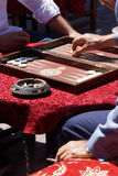 Two men playing a game of backgammon Stock Images