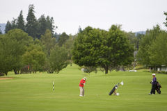Two Men Playing Golf - Horizontal royalty free stock images