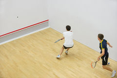 Two men playing match of squash. Stock Photo