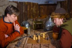 Two men playing popular strategy board game - tafl Royalty Free Stock Image