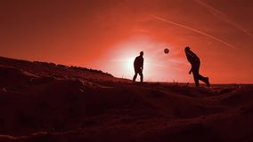 Two men playing soccer at sunset sun sand the football beach. Two men playing soccer at sunset sun sand football beach stock video