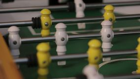 The Table Soccer Game. Two men playing table football yellow and white players foosball stock footage