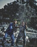 Two Men Playing With Water in Lake Royalty Free Stock Images