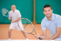 Two men poised for game tennis Stock Images