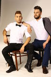 Two men portrait with  hairdress Royalty Free Stock Photo