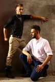 Two men portrait with style dress and hair dress Royalty Free Stock Images
