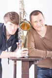 Two men posing with saxophone Royalty Free Stock Images