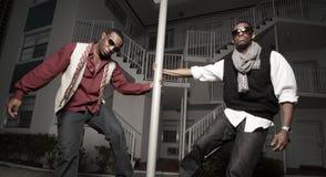 Two men posing in an urban setting Royalty Free Stock Image