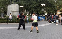 Two men practice boxing in Union Square Park New York City. NEW YORK, NEW YORK, USA - AUGUST 25: Two men practice boxing in Union Square park and 14th street Royalty Free Stock Images