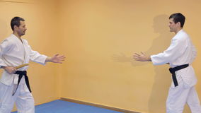 Two men practicing Aikido in the gym. Two men with black belt practicing Aikido in the gym stock footage