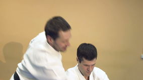 Two men practicing Aikido in the gym. stock video