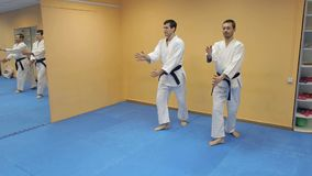 Two men practicing Aikido in the gym. Judo sport training in the sports hall stock video footage