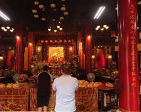 Two Men Pray at the Altar of a Temple in Taiwan Royalty Free Stock Images