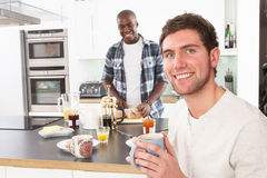 Two Men Preparing Breakfast In Kitchen Stock Photo