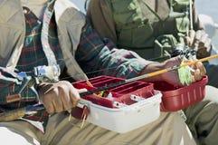 Two men preparing fishing pole Royalty Free Stock Photo