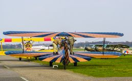 Preperations for the flight of a stunt airplane at airport seppe breda, Bosschenhoofd, The Netherlands, March 30, 2019. Two men preparing the flight of a stunt royalty free stock image