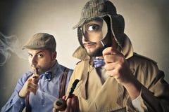Two men pretending to be investigators Stock Photos