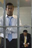 Two Men In Prison Cell. Two businessmen locked in prison cell Royalty Free Stock Photos