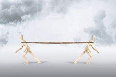 Two men pull a rope in opposite directions Stock Photos