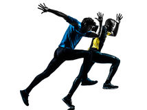 Two men racing  runner sprinter  silhouette. Two men racing  running sprinting  in silhouette studio isolated on white background Royalty Free Stock Images