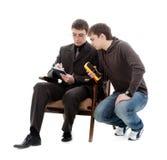 Two men recorded testimony multimeter. Two men recorded testimony multimeter, isolated on a white background Stock Images